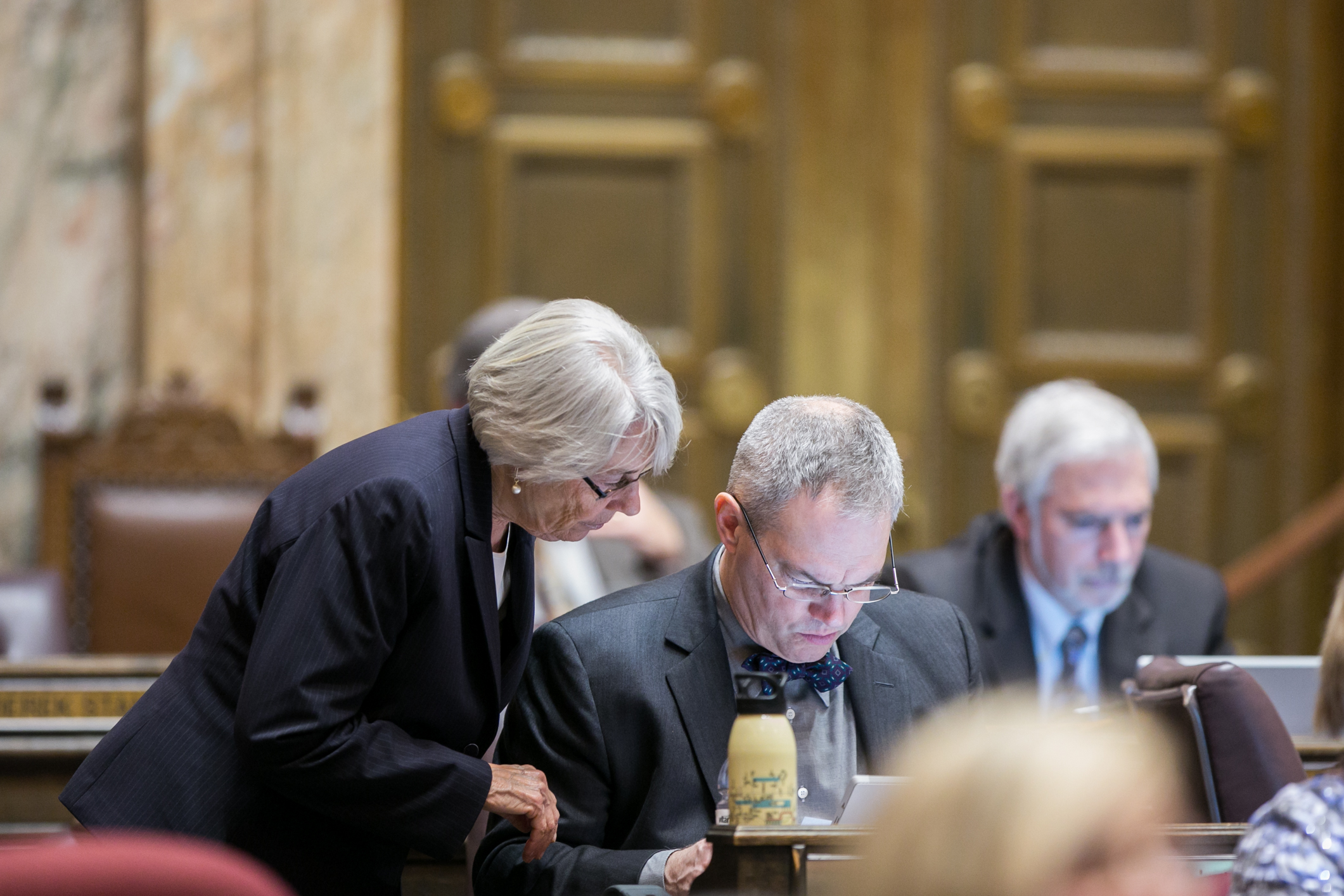 Rep. Kagi and I working on the Early Start bill on the floor of the House. My Sound Transit water bottle is in the foreground.